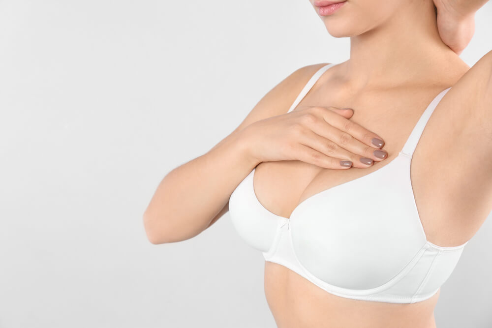 A woman after breast augmentation surgery.
