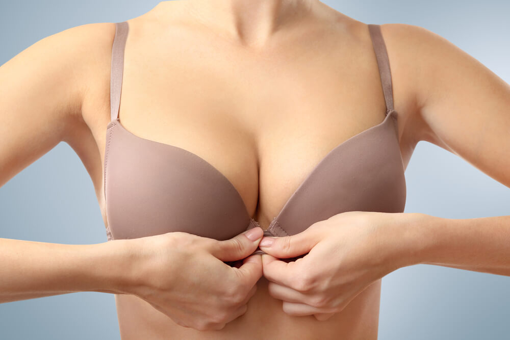 A woman happy with her breast reduction.